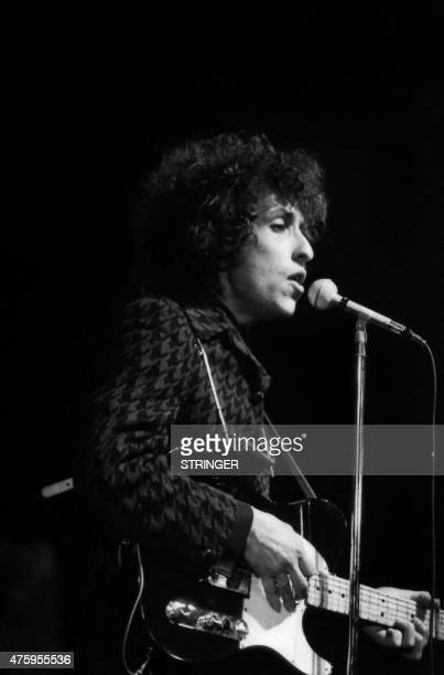 Photo taken on May 25 1966 shows American rock and folk musician Bob Dylan singing and plaing guitar during a concert at the Olympia music hall in...