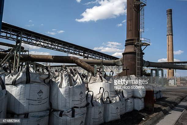 A photo taken on May 27 2015 shows gags of zinc oxide in the main yard at the Societe de Traitement du Terril factory in Lubumbashi AFP PHOTO /...