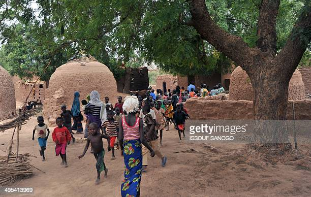 Photo taken on May 28 2012 shows inhabitants in the village of Tibiri near Dosso in Niger Although the authorities try to controil the country's...
