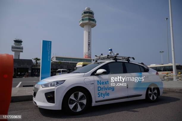 Photo taken on May 28, 2020 shows a Rideflux 'self-driving' car in Jeju. - In a workshop that blends a corporate office with a tool-packed garage,...