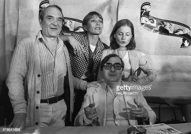 A photo taken on May 30 1978 in Cannes shows French director Claude Chabrol giving a press conference with actors Jean Carmet Stéphane Audran and...