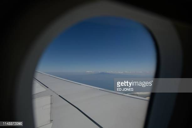 A photo taken on May 7 2019 shows a general view of Hallasan or Halla mountain from the window of an aircraft on Jeju island The volcanic Hallasan is...