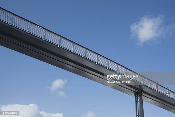 A photo taken on May 8 2015 shows women on a footbridge designed by architect Marc Mimram at the Memorial ACTe the Caribbean Centre of Expression and...