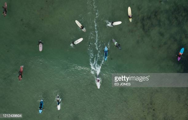 A photo taken on May 8 2020 shows an aerial view of surfers in the water at Jukdo beach near Sokcho
