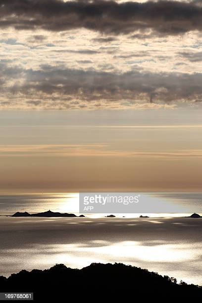 A photo taken on May 9 2012 shows a sunset over the bay of Ajaccio with the Sanguinaires islands on the French Mediterranean Island of Corsica AFP...