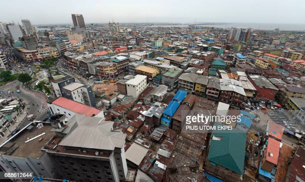 A photo taken on May 9 2017 shows a view of multistorey buildings in Lagos Nigeria's commercial capital and the megacity of some 20 million people...