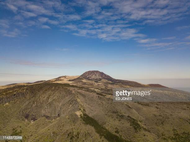 A photo taken on May 9 2019 shows a general view of Hallasan or Halla mountain on Jeju island The volcanic Hallasan is South Korea's tallest mountain...