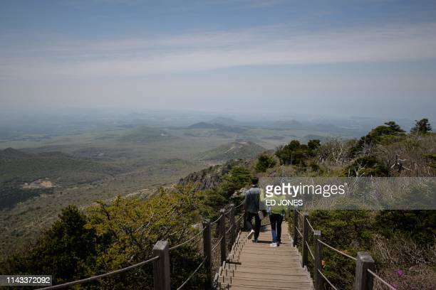 A photo taken on May 9 2019 shows hikers descending Hallasan or Halla mountain on Jeju island