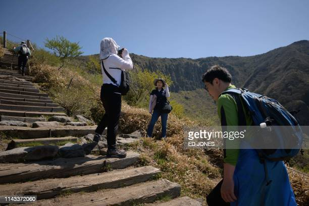 A photo taken on May 9 2019 shows hikers making their way up Hallasan or Halla mountain on Jeju island