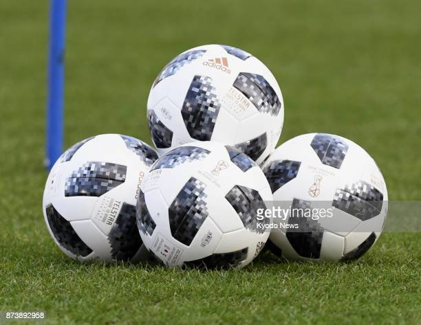 Photo taken on Nov 13 shows official balls for the 2018 FIFA World Cup finals in Russia which were used by Japan national team players during their...