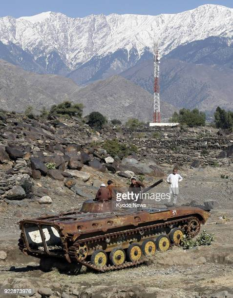 Photo taken on Nov 20 shows children playing on an abandoned combat vehicle in the eastern Afghanistan province of Nangarhar ==Kyodo