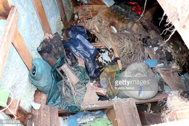 Photo taken on Nov 28 2017 shows the inside of a wooden boat apparently from North Korea that has been found washed ashore with eight bodies on a...