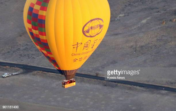 Photo taken on Nov 30 shows a hotair balloon bearing the logo of a Chinese travel agency over Cappadocia Turkey China has designated 2018 as 'Turkey...
