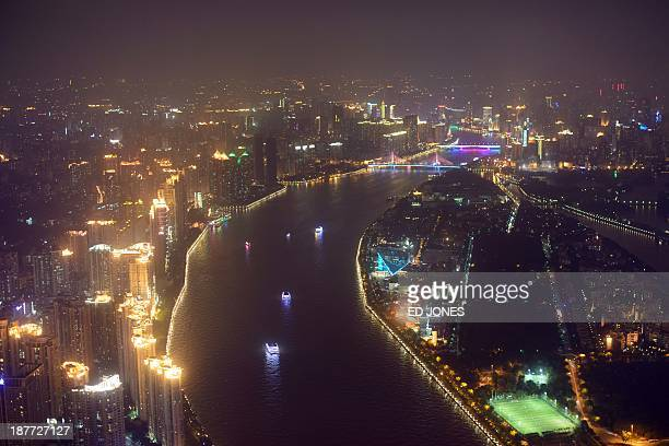 A photo taken on November 11 2013 shows the skyline of the southern Chinese city of Guangzhou China will open its stateowned firms to greater...