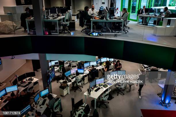 A photo taken on November 13 2018 shows the newsroom in the new headquarters of the multilingual news television channel Euronews in Lyon's...