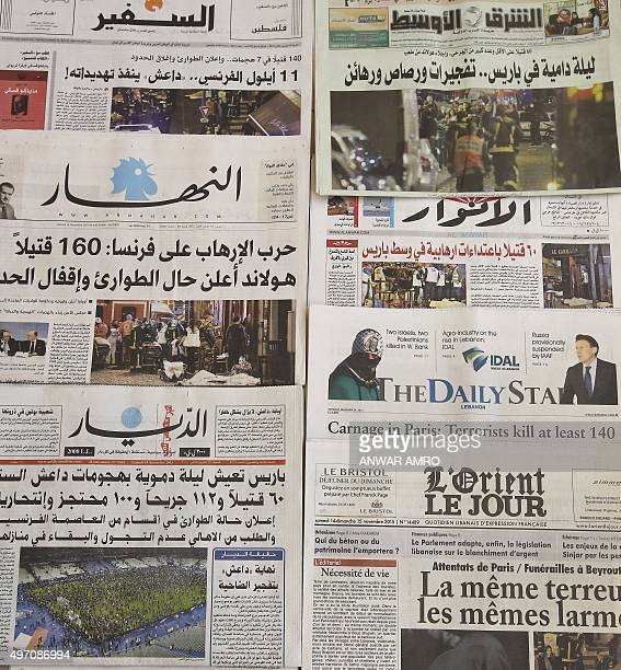 Photo taken on November 14, 2015 in the Lebanese capital Beirut shows newspapers bearing the headlines of the deadly Paris attack. French President...