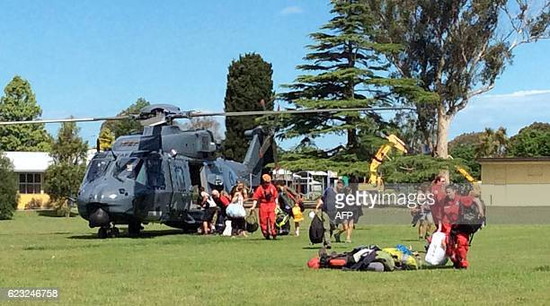 A photo taken on November 15 shows a New Zealand Defence Force helicopter landing at Woodend after evacuating some of 1200 of tourists from Kaikoura...