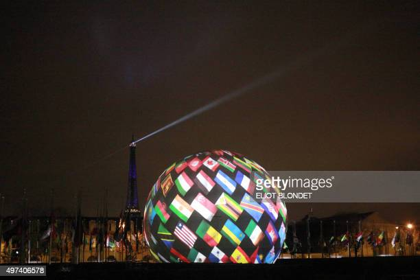 A photo taken on November 16 2015 at the UNESCO headquarters in Paris shows a projection of pictures during the celebration of the 70th anniversary...