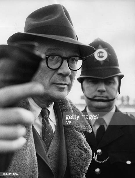 A photo taken on November 17 1963 shows Professor Frederick C Barghoorn as he is about to board an airliner at London airport to fly home to America...