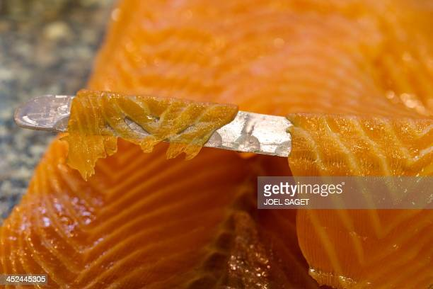 Photo taken on November 18, 2013 in Paris shows a slice of smoked salmon at one of the shops of Petrossian, the world's leading distributor of...