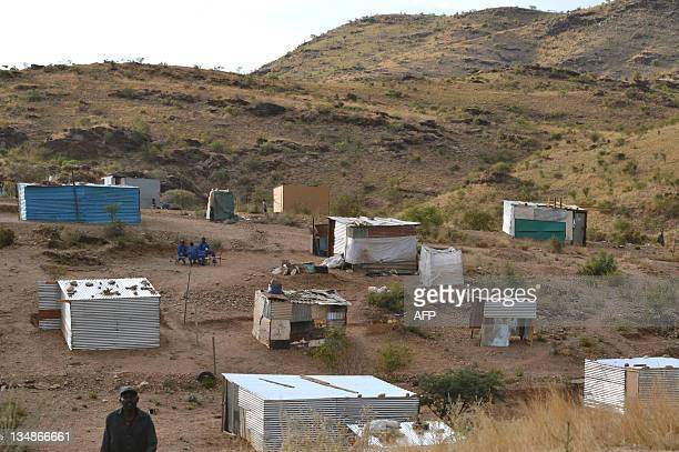 A photo taken on November 19 2011 shows shacks in the northwestern outskirts of the Namibian capital Windhoek Trees which formerly were abundant had...