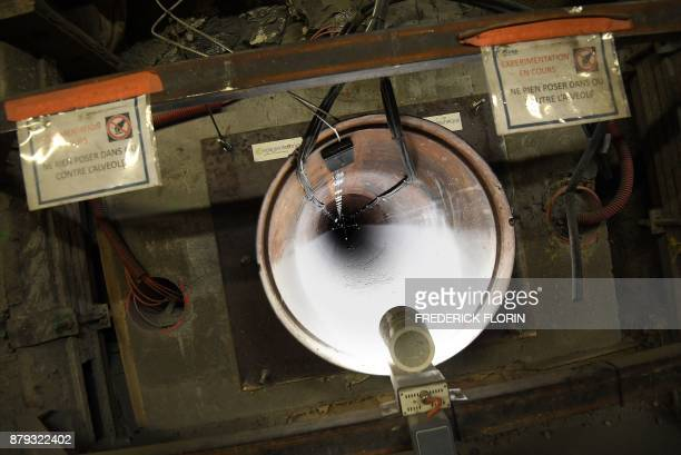 A photo taken on November 21 2017 shows a 70centimetrediameter boreholes called alveolus with measuring instruments made to store nuclear waste 490m...