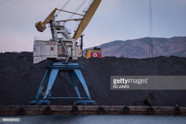 A photo taken on November 21 2017 shows a mound of North Korean coal adjaecent to the the RasonConTrans coal port at Rajin harbour in the Rason...