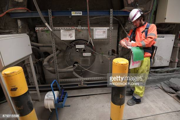 A photo taken on November 21 2017 shows an employee working on a 70centimetrediameter boreholes called alveolus made to store nuclear waste 490m deep...