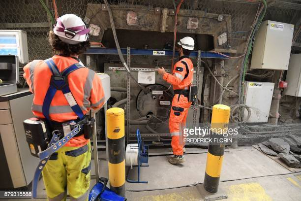 A photo taken on November 21 2017 shows employees working on a 70centimetrediameter boreholes called alveolus made to store nuclear waste 490m deep...