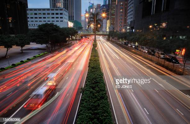 A photo taken on November 23 2011 shows a taxi making its way through rushhour traffic in Hong Kong As rush hour approaches the streets of Hong Kong...