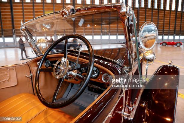 A photo taken on November 26 208 shows a 1926 convertible Hispano Suiza H6B on display in Orly outside of Paris ahead of the Retromobile 2019 auction...