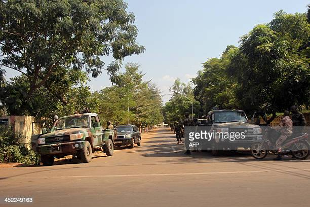 A photo taken on November 27 2013 shows Malian soldiers gathered outside Amadou Haya Sanogo's residence in Bamako Amadou Sanogo who led a March 2012...