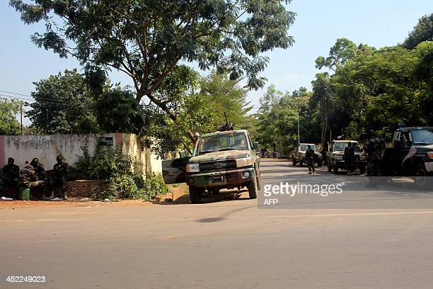 A photo taken on November 27 2013 shows Malian soldiers standing outside Amadou Haya Sanogo's residence in Bamako Amadou Sanogo who led a March 2012...