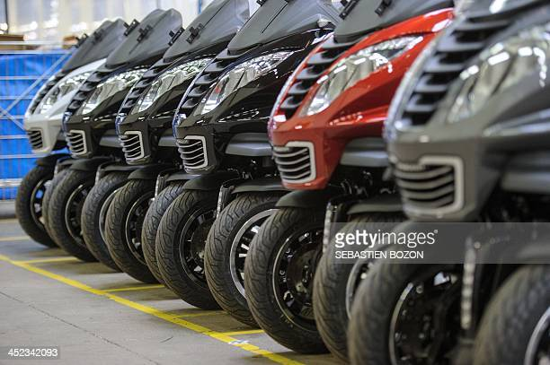 Photo taken on November 28, 2013 shows Peugeot Metropolis motorcycles parked in a at the factory of the French car and motorcycle maker PSA Peugeot...
