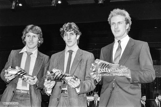 Photo taken on November 4, 1982 shows Brazilian player Zico, Italian player Paolo Rossi and German player Karl-Heinz Rummenigge posing with trophies...