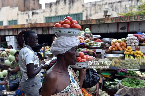 Photo taken on November 6, 2014 shows fruit and vegetable sellers at a market in Ouagadougou, Burkina Faso. Burkina Faso's army-appointed leader on...