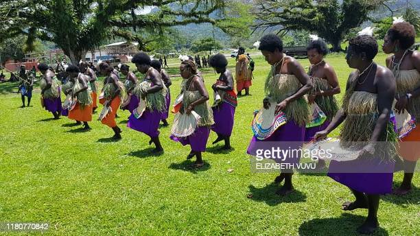 Photo taken on November 6 2019 shows women in tribal colours dancing at a Bougainville reconciliation ceremony ahead of independence referendum in...