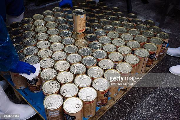 A photo taken on November 8 2016 show cans of duck confit on the production line near the southern village of Milevo Like every Christmas foie gras...