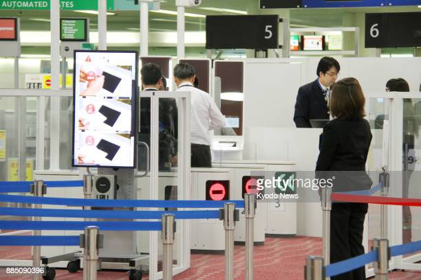 Photo taken on Oct 18 shows gates equipped with facial recognition systems at Tokyo's Haneda airport installed as part of an effort to tighten...