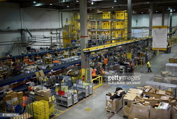 A photo taken on October 10 2016 shows the Amazon distribution center in Saran / AFP / GUILLAUME SOUVANT