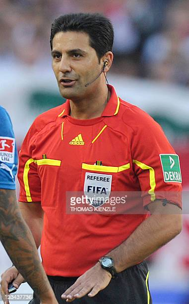 Photo taken on October 15 2011 showing Referee Babak Rafati speaking to a player during the German first division Bundesliga football match between...