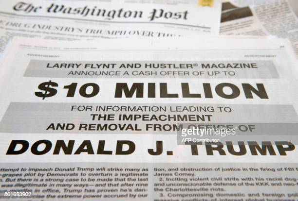 A photo taken on October 15 2017 in in Washington DC shows a fullpage newspaper advertisement in the Washington Post offering 10 million dollars from...