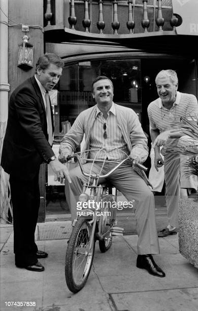 Photo taken on October 2 1984 in Nice shows Italian actor Aldo Maccione on a bicycle next to French road racing cyclist Jacques Anquetil and a friend...