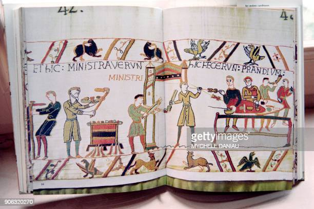 Photo taken on October 2 1990 shows a book written by Sylvette Lemagnen conservator of the Bayeux tapestry representing a scene of the Bayeux...