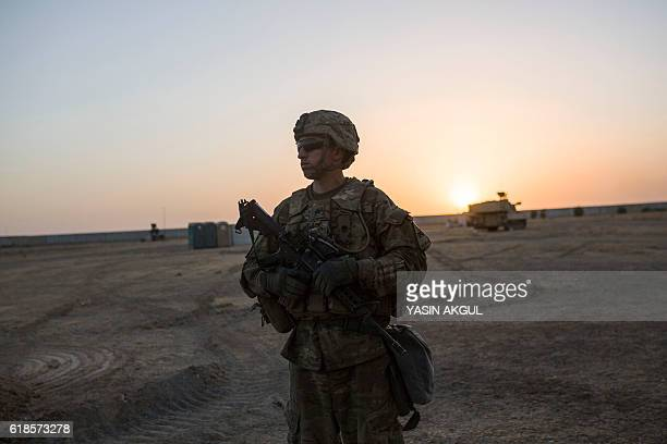 TOPSHOT A photo taken on October 20 2016 shows a US soldier standing at the Qayyarah military base during the ongoing operation to recapture the last...