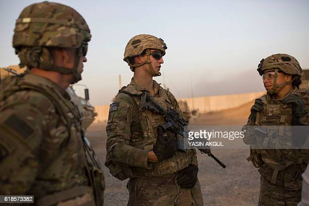 A photo taken on October 20 2016 shows US soldiers talking at the Qayyarah military base during the ongoing operation to recapture the last major...