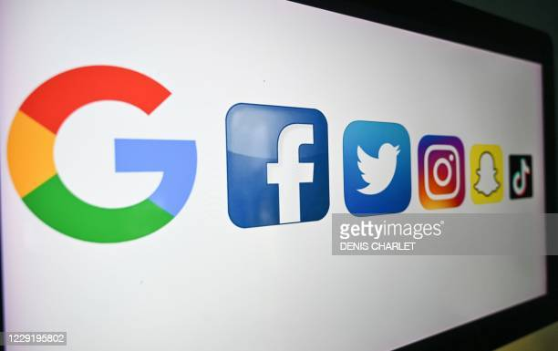 Photo taken on October 21, 2020 shows the logo of the multinational American Internet technology and services company, from left : Google, the...