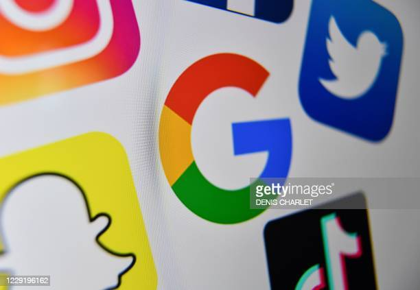 A photo taken on October 21 2020 shows the logo of the multinational American Internet technology and services company Google the American online...