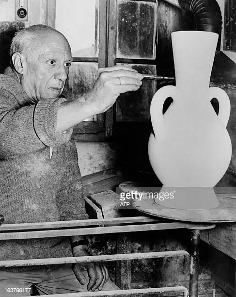 A photo taken on October 22 1961 shows Spanish artist Pablo Picasso painting a potery at the Madoura studio in Vallauris AFP PHOTO