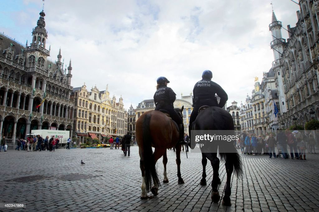 A photo taken on October 23, 2013 shows mounted police patrolling in the center of Brussels before a football match opposing Belgian team RSC Anderlecht to French team Paris Saint-Germain